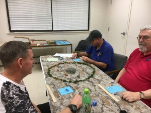 Dave, Eric, and Colonel Sanders play Eric's fantasy skirmish game.
