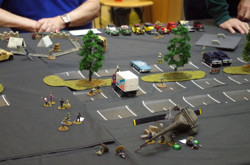 Part of the table including the downed helicopter and the the stunned survivors waiting to be escorted to safety or eaten.